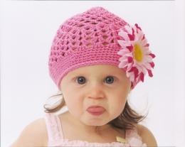 cute kids showing her tongue