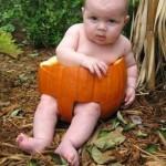 funny baby in pumpkin