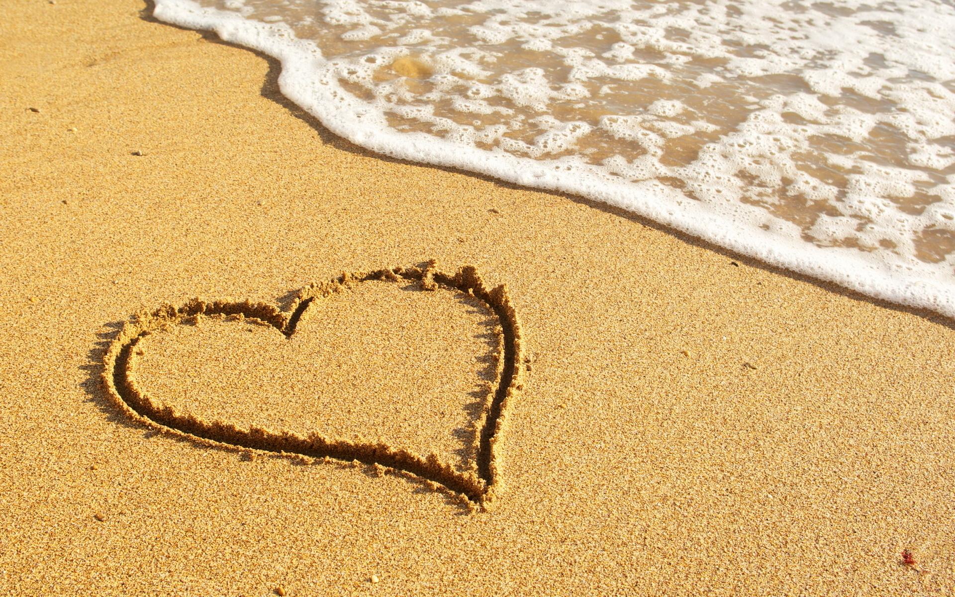 beautiful love heart on sand