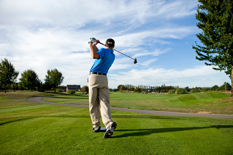 playing boy golf image