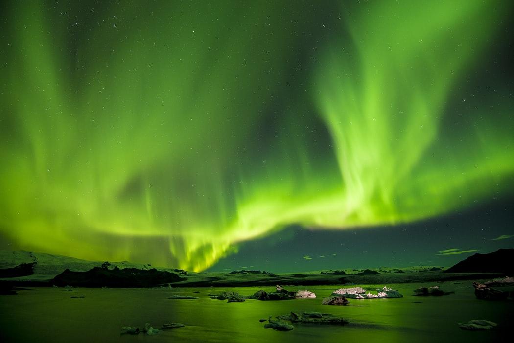 dark green Northern Lights Wallpaper