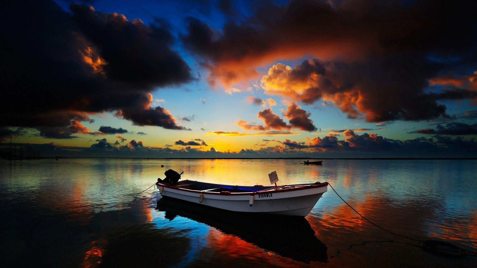 boat in sea HD Sunset Wallpaper